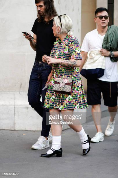 A guest wears a colorful dress and a Gucci bag outside the OAMC show during Paris Fashion Week Menswear Spring/Summer 2018 on June 21 2017 in Paris...