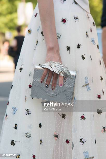 A guest wears a Dior dress and a Ralph and Russo bag day 2 of Paris Haute Couture Fashion Week Autumn/Winter 2017 on July 3 2017 in Paris France