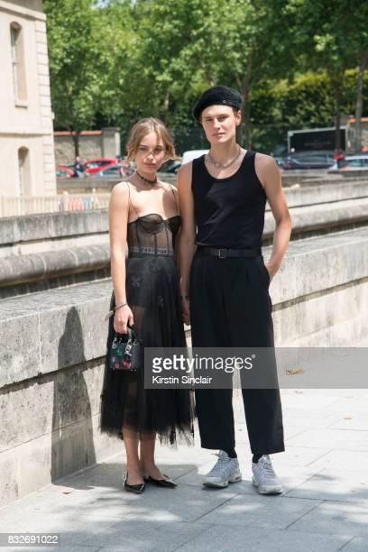 A guest wears a Dior dress bag and shoes with another guest wearing a black beret black vest and trousers with trainers day 2 of Paris Haute Couture...