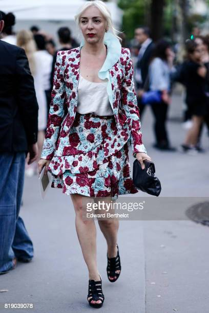 A guest wears a flower print blazer jacket a flower print skirt a white lowneck top black shoes outside the launch party for Chanel's new perfume...