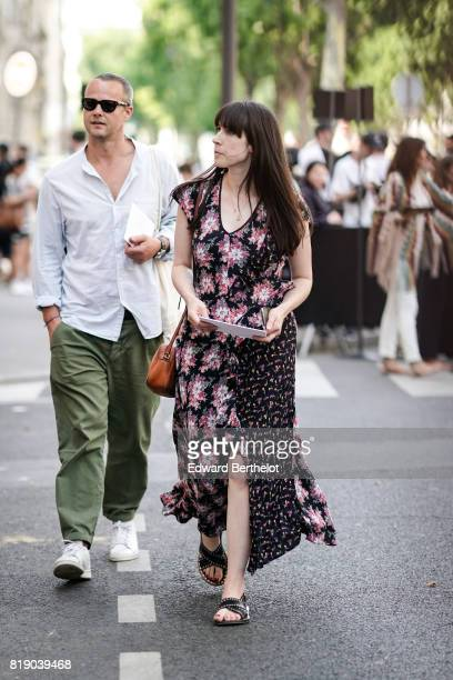 A guest wears a flower print dress a brown bag and sandals outside the Valentino show during Paris Fashion Week Menswear Spring/Summer 2018 on June...