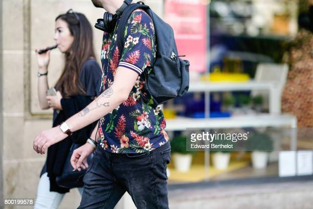 A guest wears a flower print shirt after the CDG Comme des Garcons show during Paris Fashion Week Menswear Spring/Summer 2018 on June 23 2017 in...