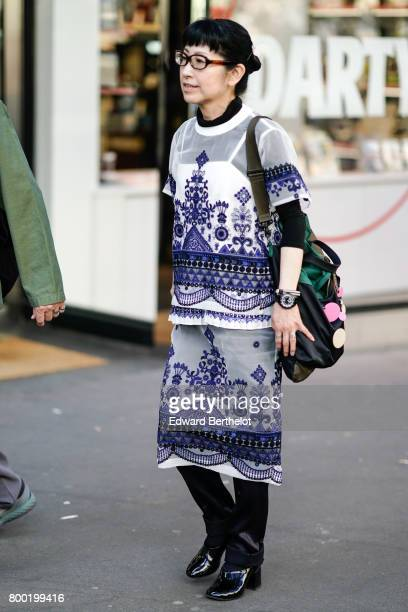 A guest wears a full outfit with prints after the CDG Comme des Garcons show during Paris Fashion Week Menswear Spring/Summer 2018 on June 23 2017 in...