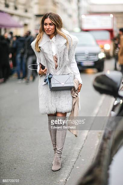 A guest wears a gray fur coat and a Diorama bag from Dior outside the Jean Paul Gaultier show during Paris Fashion Week Haute Couture Spring Summer...