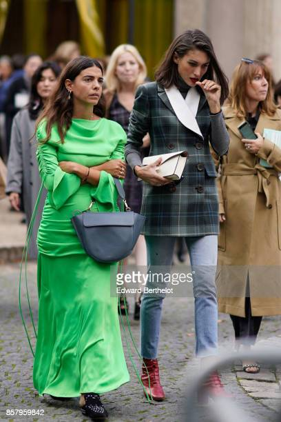A guest wears a green dress a semi circular bag a guest wears a tartan blazer jacket outside Miu Miu during Paris Fashion Week Womenswear...
