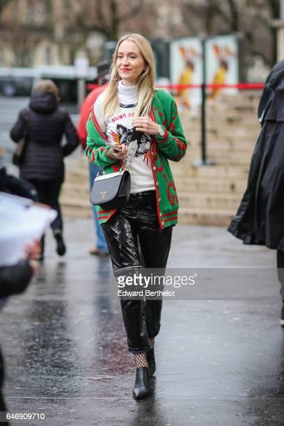 A guest wears a green jacket an black vinyl pants outside the Rochas show during Paris Fashion Week Womenswear Fall/Winter 2017/2018 on March 1 2017...