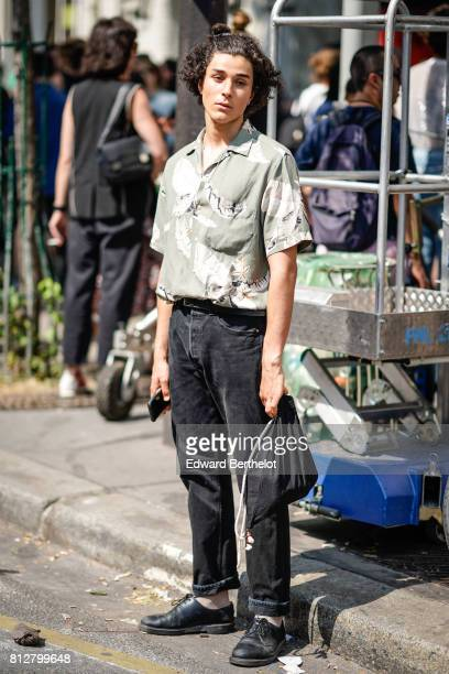 A guest wears a green shirt and black pants outside the Y/Project show during Paris Fashion Week Menswear Spring/Summer 2018 on June 21 2017 in Paris...
