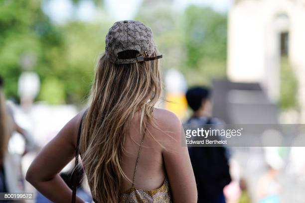 A guest wears a Gucci cap outside the Cerruti show during Paris Fashion Week Menswear Spring/Summer 2018 on June 23 2017 in Paris France