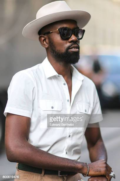 A guest wears a hat sunglasses a white shirt outside the Hermes show during Paris Fashion Week Menswear Spring/Summer 2018 on June 24 2017 in Paris...