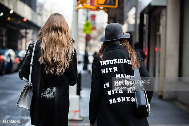 A guest wears a 'Intoxicated with madness I'm in love with my sadness' Sylvia Plath / Smashing Pumpkins text jacket outside the Valentino PreFall...