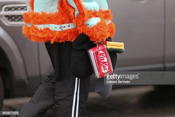 A guest wears a Kit Kat clutch outside the Alexis Mabille show at Place Vendome during Paris Fashion Week Haute Couture Spring Summer 2017 on January...