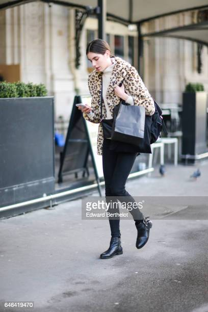 A guest wears a leopard print fur coat outside the Olivier Theyskens show during Paris Fashion Week Womenswear Fall/Winter 2017/2018 on February 28...