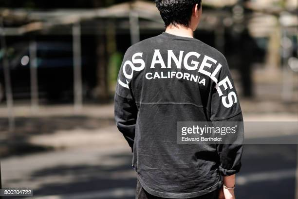 A guest wears a Los Angeles pull over outside the Christian Dada show during Paris Fashion Week Menswear Spring/Summer 2018 on June 23 2017 in Paris...