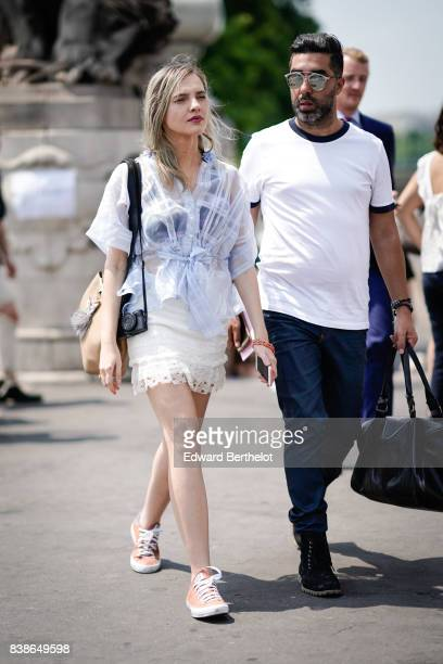 A guest wears a mesh shirt a lace white skirt sneakers outside the Icosae show during Paris Fashion Week Menswear Spring/Summer 2018 on June 21 2017...