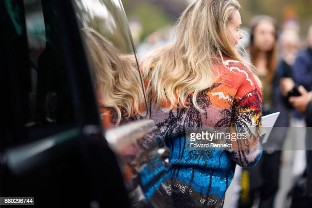 A guest wears a multicolor jacket with coconut trees pattern outside Lanvin during Paris Fashion Week Womenswear Spring/Summer 2018 on September 27...