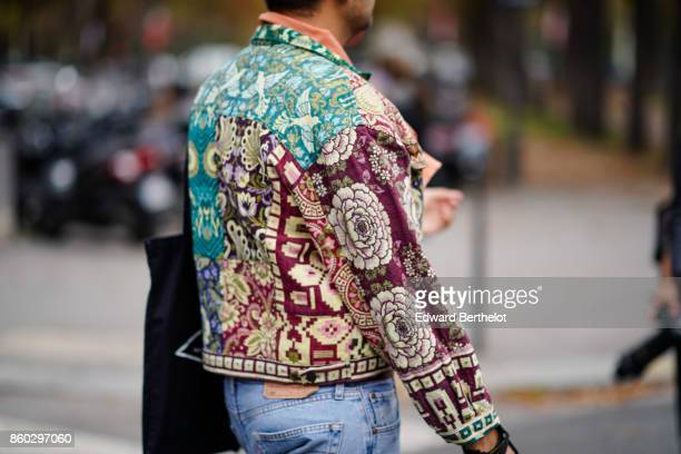 A guest wears a multicolor jacket with flowers and birds prints outside Lanvin during Paris Fashion Week Womenswear Spring/Summer 2018 on September...