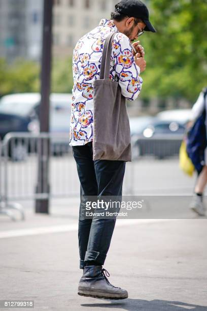 A guest wears a multicolor shirt a black cap outside the Icosae show during Paris Fashion Week Menswear Spring/Summer 2018 on June 21 2017 in Paris...