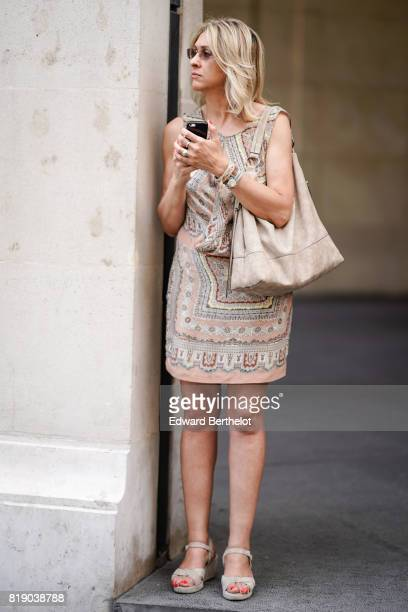A guest wears a pattern camel dress a camel bag outside the Elie Saab show during Paris Fashion Week Haute Couture Fall/Winter 20172018 on July 5...