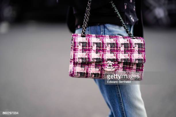 A guest wears a pink and grey tweed Chanel bag outside Lanvin during Paris Fashion Week Womenswear Spring/Summer 2018 on September 27 2017 in Paris...
