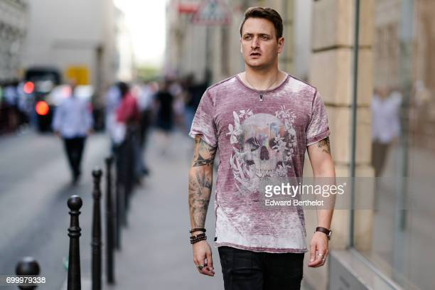 A guest wears a pink tshirt with a printed skull outside the OAMC show during Paris Fashion Week Menswear Spring/Summer 2018 on June 21 2017 in Paris...