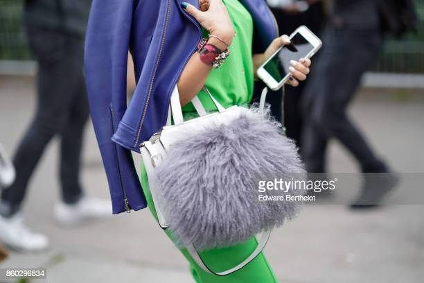 A guest wears a purple leather jacket an applegreen outfit a white bag with a big grey fur bobble outside Lanvin during Paris Fashion Week Womenswear...