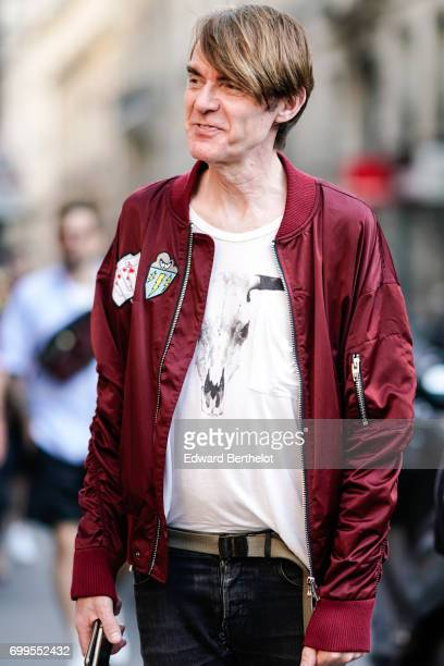 A guest wears a red bomber jacket a white tshirt outside the OAMC show during Paris Fashion Week Menswear Spring/Summer 2018 on June 21 2017 in Paris...