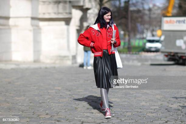A guest wears a red bomber jacket and a black skirt outside the Manish Arora show during Paris Fashion Week Womenswear Fall/Winter 2017/2018 on March...
