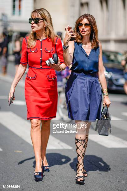 A guest wears a red dress and sunglasses a guest wears sunglasses a blue vneck dress with fishnet tights and a black bag outside the Jean Paul...
