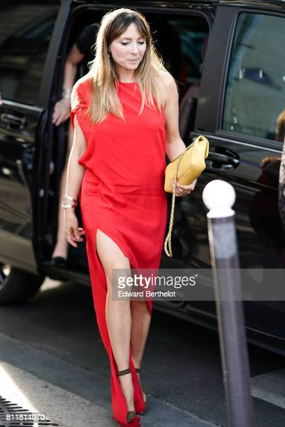 A guest wears a red dress outside the launch party for Chanel's new perfume 'Gabrielle' during Paris Fashion Week Haute Couture Fall/Winter 20172018...