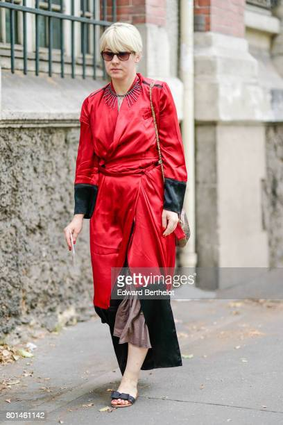 A guest wears a red silk kimono dress outside the Paul Smith show during Paris Fashion Week Menswear Spring/Summer 2018 on June 25 2017 in Paris...