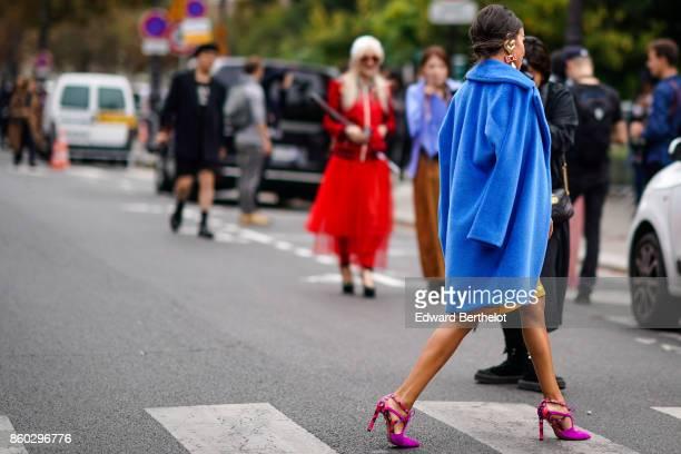 A guest wears a royal blue coat pink stilettos outside Lanvin during Paris Fashion Week Womenswear Spring/Summer 2018 on September 27 2017 in Paris...