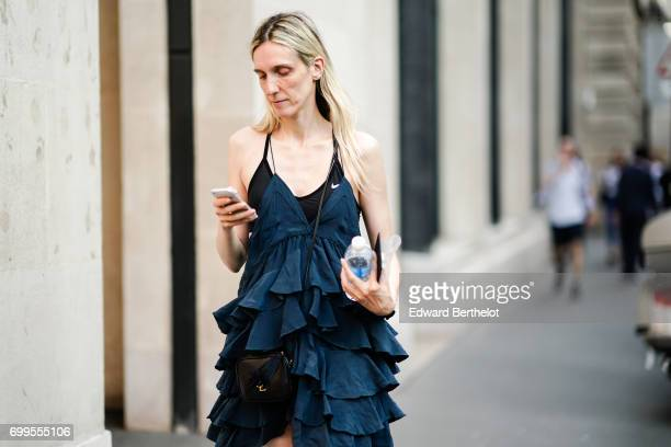 A guest wears a ruffled dress outside the OAMC show during Paris Fashion Week Menswear Spring/Summer 2018 on June 21 2017 in Paris France
