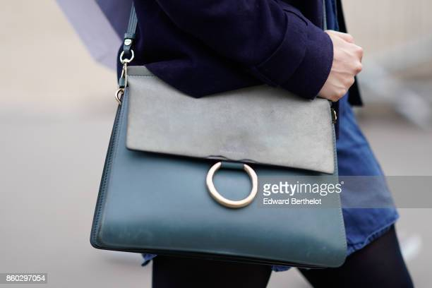 A guest wears a shades of blue bag outside Lanvin during Paris Fashion Week Womenswear Spring/Summer 2018 on September 27 2017 in Paris France