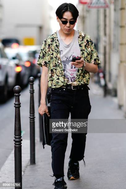 A guest wears a shirt a gray top and black pants outside the OAMC show during Paris Fashion Week Menswear Spring/Summer 2018 on June 21 2017 in Paris...