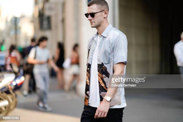 A guest wears a shirt outside the OAMC show during Paris Fashion Week Menswear Spring/Summer 2018 on June 21 2017 in Paris France