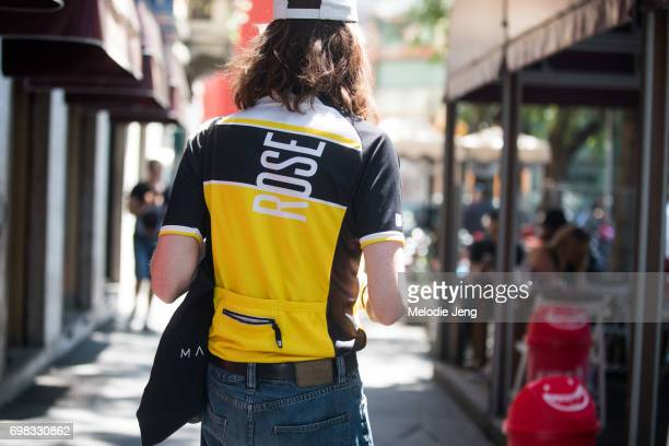 A guest wears a shirt with 'rose' text and a back pocket during Milan Men's Fashion Week Spring/Summer 2018 on June 19 2017 in Milan Italy