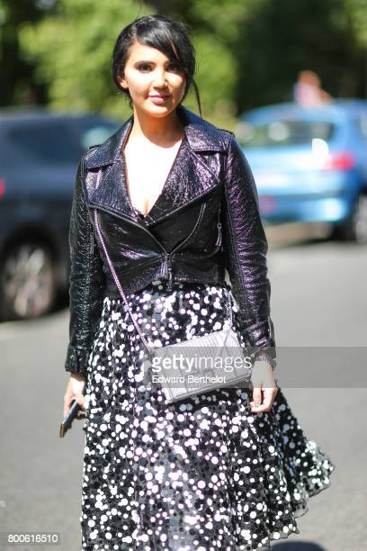 A guest wears a silver Dior diorama bag outside the Dior show during Paris Fashion Week Menswear Spring/Summer 2018 on June 24 2017 in Paris France