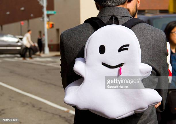A guest wears a Snapchat backpack at Skylight Clarkson Sq outside the John Elliott show wearing ghost backpack by Snapchat during New York Fashion...