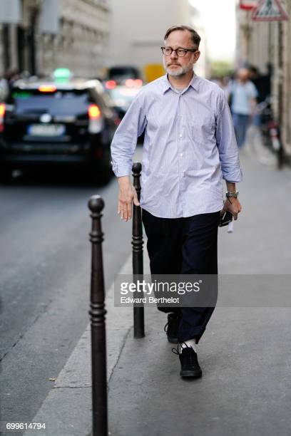 A guest wears a striped shirt outside the OAMC show during Paris Fashion Week Menswear Spring/Summer 2018 on June 21 2017 in Paris France