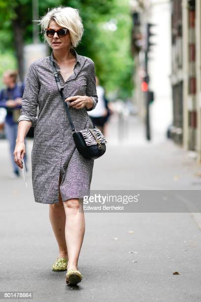 A guest wears a tweed dress and a zebra print bag outside the Paul Smith show during Paris Fashion Week Menswear Spring/Summer 2018 on June 25 2017...
