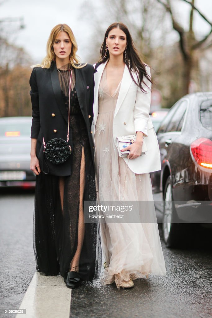 A guest wears a white blazer jacket, and a dress, outside the Rochas show, during Paris Fashion Week Womenswear Fall/Winter 2017/2018, on March 1, 2017 in Paris, France.