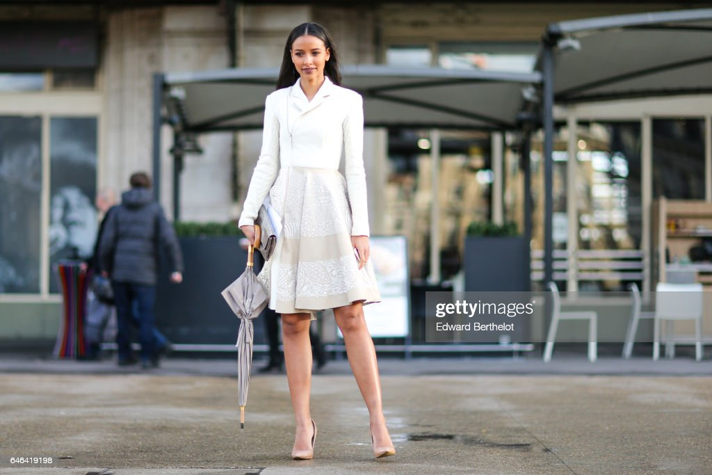 A guest wears a white dress, and nude heels, outside the Olivier Theyskens show, during Paris Fashion Week Womenswear Fall/Winter 2017/2018, on February 28, 2017 in Paris, France.