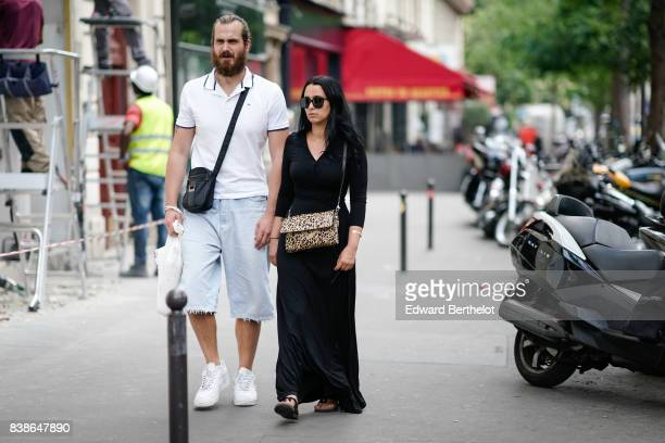 A guest wears a white polo a black bag cropped jeans white sneakers a guest wears sunglasses a black dress leopard print bag outside the Y/Project...