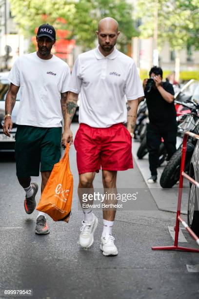 A guest wears a white polo shirt red shorts and white sneakers outside the OAMC show during Paris Fashion Week Menswear Spring/Summer 2018 on June 21...