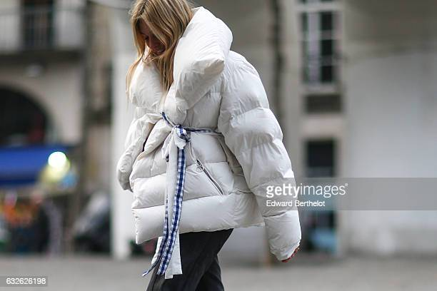 A guest wears a white puffer coat with fur outside the Vetements show at Centre Pompidou during Paris Fashion Week Haute Couture Spring Summer 2017...