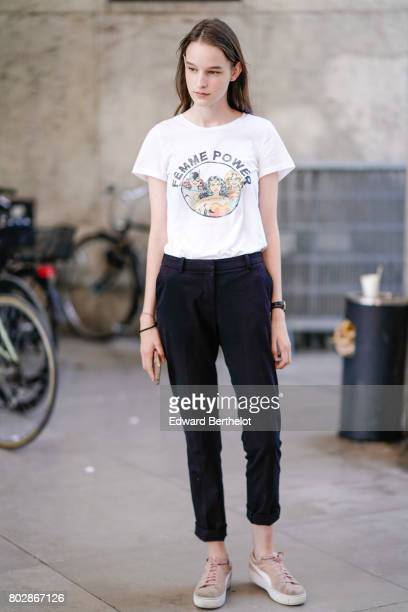 A guest wears a white tshirt black pants outside the 22/4 Hommes show during Paris Fashion Week Menswear Spring/Summer 2018 on June 23 2017 in Paris...