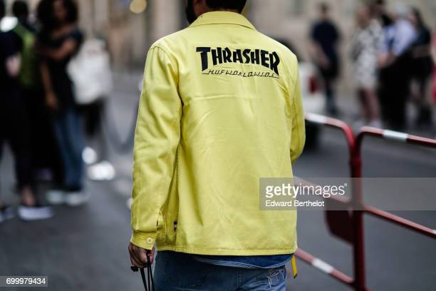 A guest wears a yellow jacket outside the OAMC show during Paris Fashion Week Menswear Spring/Summer 2018 on June 21 2017 in Paris France