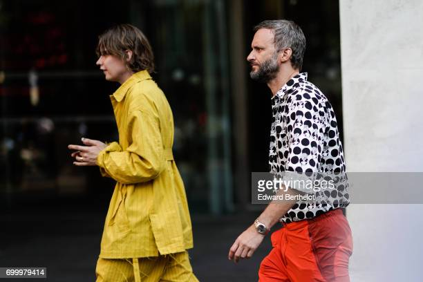 A guest wears a yellow outfit outside the OAMC show during Paris Fashion Week Menswear Spring/Summer 2018 on June 21 2017 in Paris France