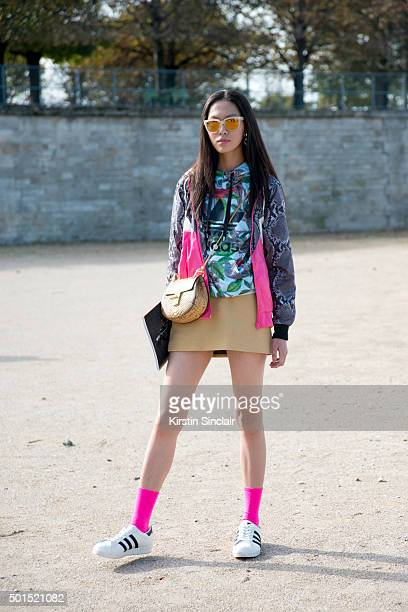 A guest wears Adidas trainers top and jacket chloe bag on day 8 during Paris Fashion Week Spring/Summer 2016/17 on October 6 2015 in Paris France