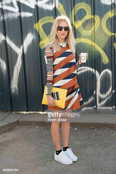 A guest wears all Kenzo Adidas trainers and Kenzo bag on day 6 of Paris Collections Women on March 08 2015 in Paris France